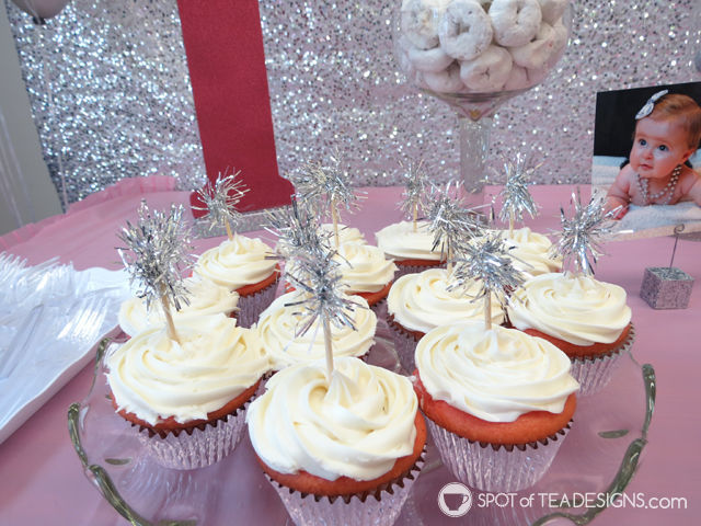 "Sparkling First #Birthday #Party featuring a pink and silver sparkle color palette - cupcakes with tinsel ""sparkler"" cake toppers 