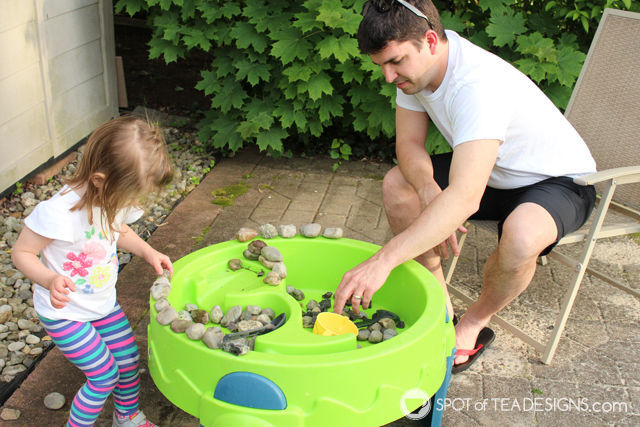 3 Fun Outdoor Activities for Toddlers this summer - Rock play in water table. #ad #TopYourSummer #SoHoppinGood |spotofteadesigns.com