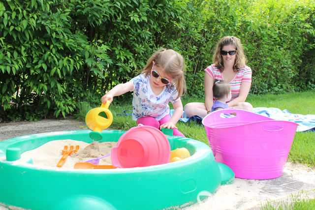 3 Fun Outdoor Activities for Toddlers this summer - Allow water to mix with sand in sandbox. #ad #TopYourSummer #SoHoppinGood |spotofteadesigns.com