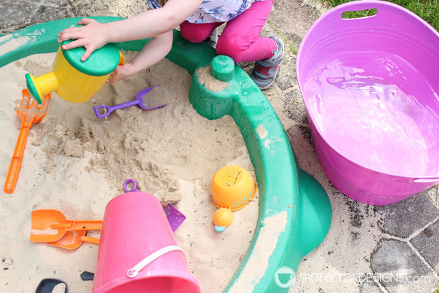 3 Fun Outdoor Activities for Toddlers this summer - Allow water to mix with sand in sandbox. #ad #TopYourSummer #SoHoppinGood  spotofteadesigns.com