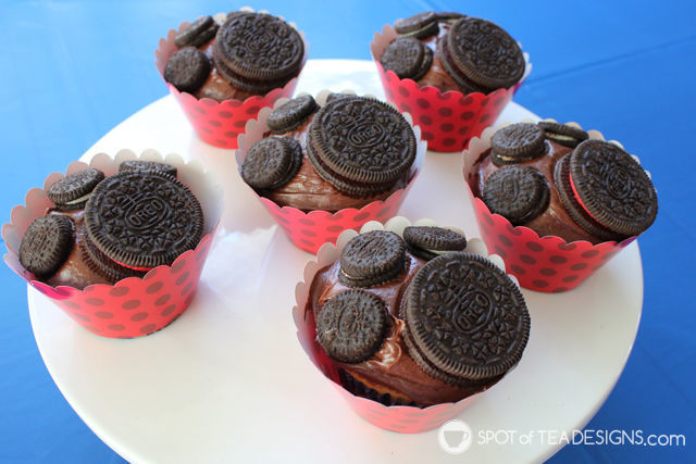 3 mini and one regular Oreo cookie on a cupcake to make a paw print! #pawpatrol #cupcake #oreo | spotofteadesigns.com