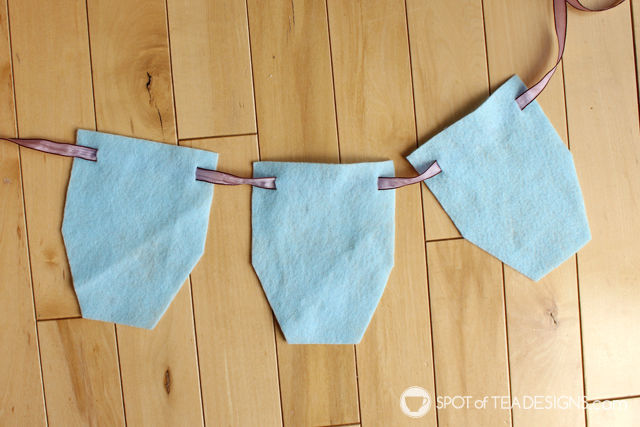 First Birthday DIY Craft - High Chair Garland using ribbon scraps! #party #DIY #firstbirthday | Spotofteadesigns.com