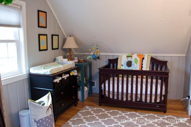 Gender Neutral Modern Animal #Nursery. Crib fits under slanted ceiling wall | spotofteadesigns.com