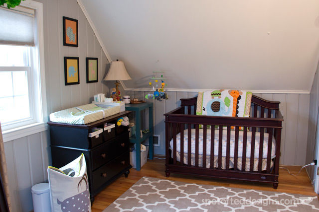 Gender Neutral Modern Animal #Nursery. Crib fits under slanted ceiling wall | spotofteadesigns.com