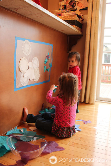 Winter Sticky Wall - Contact paper activity for toddlers with a winter theme | spotofteadesigns.com