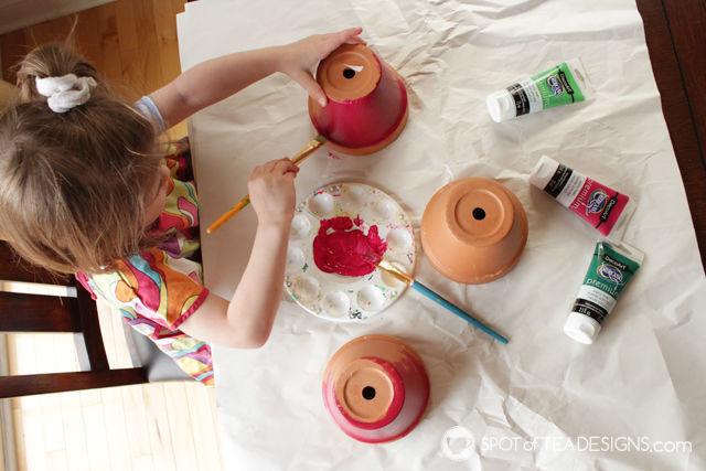 Watermelon utensil pot - paint terra cotta pots for festive table decor for your summer party!   spotofteadesigns.com