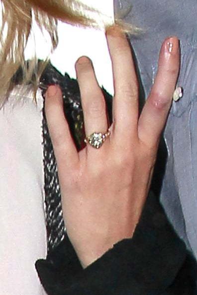Miley Cyrus with Givenchy Nightingale Bag and Engagement