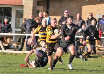Luke Turner breaks free to score for Ely Tigers