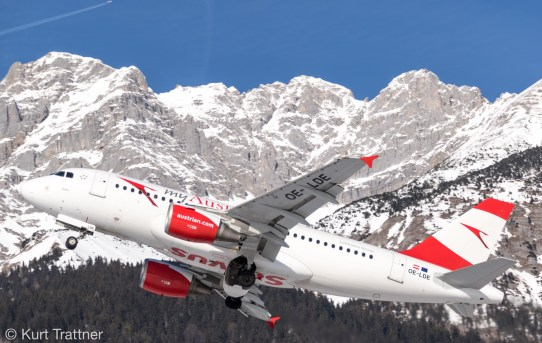 Austrian A319 in front of the beautiful mountains