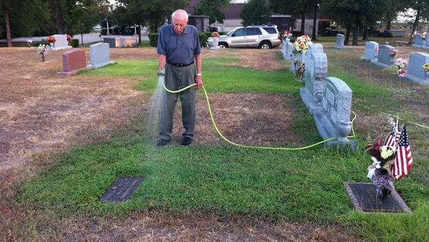 86 Year Old Conroe Man Waters Grave Site For His Wife And Fallen Solider