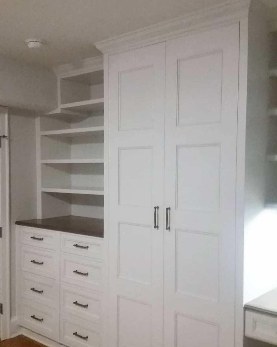 White custom closet and built-in dresser
