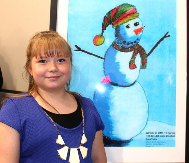 Erica Tickle, Smith Elementary School student, is pleased that her snowman design won first place