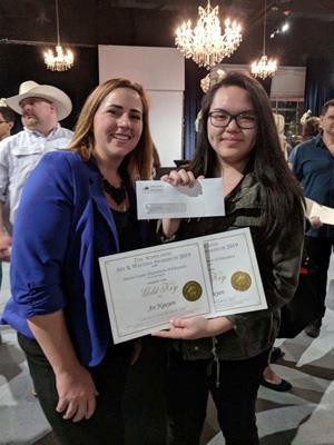 Spring High School art teacher Amanda Beisert, on left, celebrates with junior An Nguyen at the regional awards ceremony