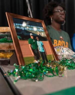 Yoni Moore displays a picture of her future coach at Baylor University