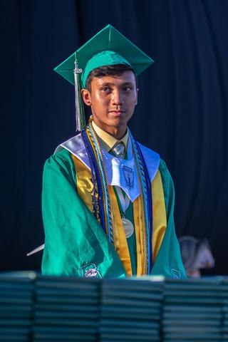 Spring ISD EMERGE Fellow and Spring High School Valedictorian Nathaniel Tutop is recognized during his school's graduation ceremony