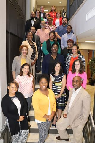 Spring ISD staff who are members of the cohort enrolled in the Houston Baptist University leadership program, along with district administrators, gather for a celebratory photo with the 10 grant winners