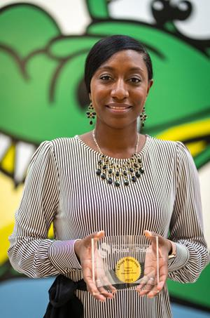 Anderson Elementary School Assistant Principal LaToya Patterson stands with the Point of Pride award she received from the Spring ISD Board of Trustees in honor of her election as TEPSA Region 4 President-Elect