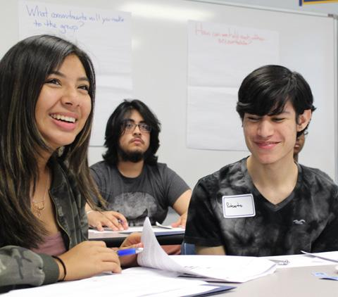 Spring High School junior Diana Salmeron, together with Spring Early College Academy juniors Kevin Bonilla and Roberto Sauceda, in a group discussion during a recent meeting of the Spring ISD EMERGE Fellows'