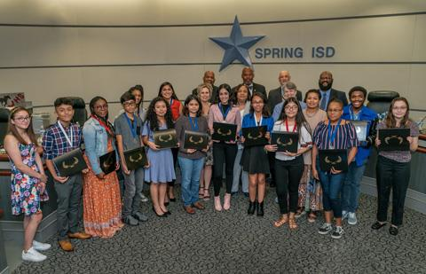 Winners of the National Hispanic Heritage Month Art and Essay Contest join the Board and Dr. Watson in the horseshoe for a congratulatory photo