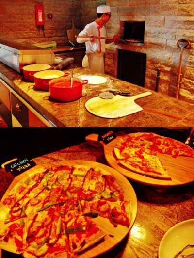 Thin crust pizzas that were made on the spot