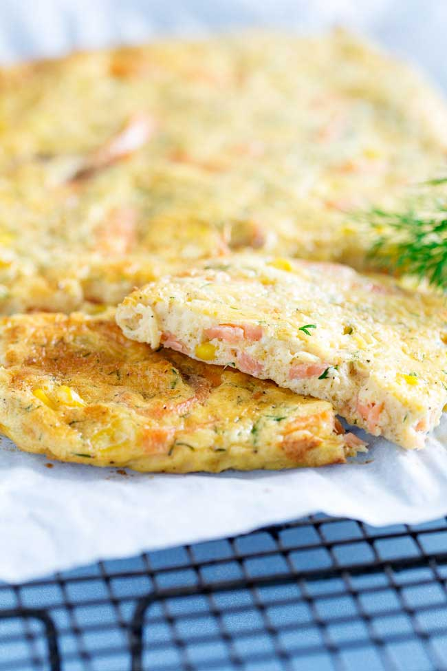 This Smoked Salmon Frittata is oven baked in a sheet pan, making it perfect for feeding a group. Enjoy it at any time of day. Personally I like it for brunch with a glass of bucks fizz.