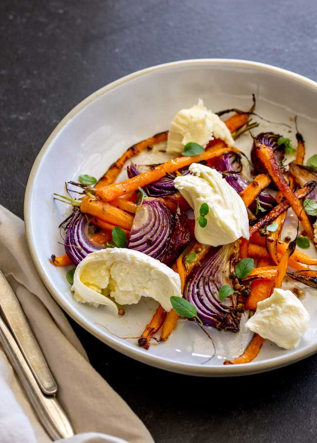 Sweet sticky caramelised vegetables, a spiced vinaigrette and soft smooth milky mozzarella. This Spiced Carrot, Red Onion and Mozzarella Salad is the salad for people who don't like salad. The carrots are nutty and sweet, the onion is sticky and fragrant, the dressing perks everything up and then then mozzarella calms and cools. The perfect salad for so many occasions. From Sprinkles and Sprouts.