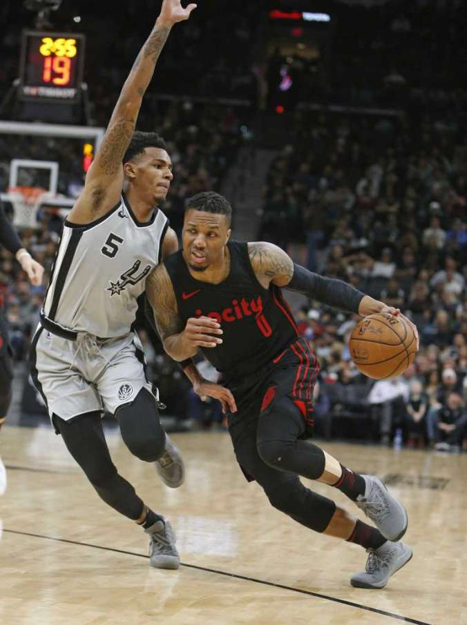 Dejounte Murray guards Damian Lillard