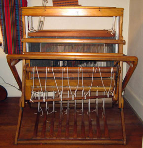 Bernat Superior Loom Model 131-B Collapsible Floor Loom with 8 shafts and 10 treadles.