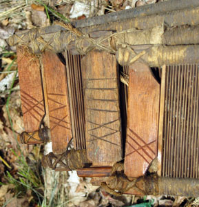 Marks on the ends of the old reeds that came with the loom in the Old Garrison House, marks appear to be Roman numerals.