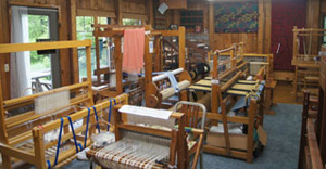 Saunderstown Weaving School overview of many looms.