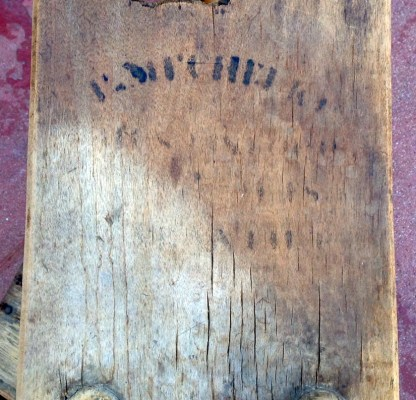 Water-damaged stencil markings on the table
