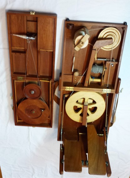 Attaché-size charkha wheel on left, Journey Wheel on right.