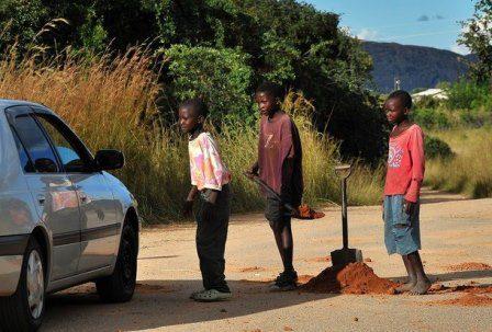 Kids Fill Potholes