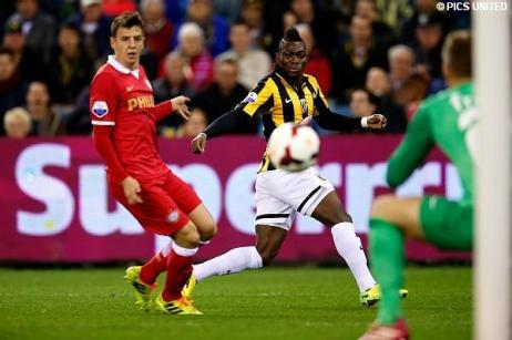 Christian Atsu watches on as his effort is saved by the PSV keeper