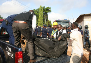 The deceased being carried to the morgue