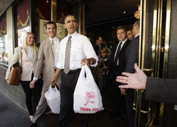 U.S. President Barack Obama leaves a Chinese restaurant in San Francisco
