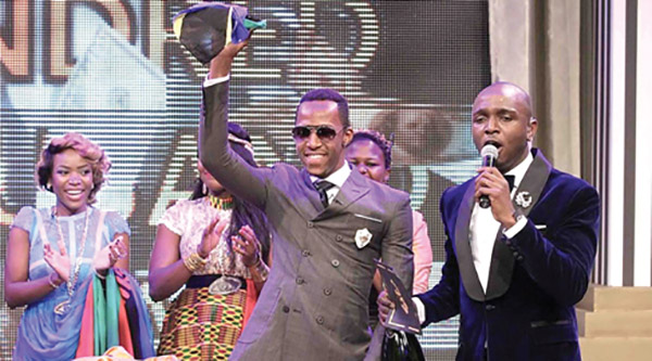 TANZANIA Iddris Sultani (second right) waves shortly after being declared winner of the Big Brother Africa (BBA) Hotshot winner in Johanneburg, South Africa.