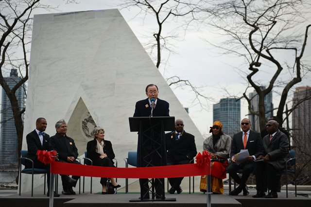"UN Secretary-General Ban Ki-moon (C) speaks during the unveiling ceremony of a permanent memorial named ""Ark of Return"" to honour the victims of slavery and the transatlantic slave trade, at the UN headquarters in New York, on March 25, 2015. The UN unveiled a permanent memorial at the UN Headquarters in New York on Wednesday to honor the victims of slavery and the transatlantic slave trade. (Xinhua/Niu Xiaolei)"