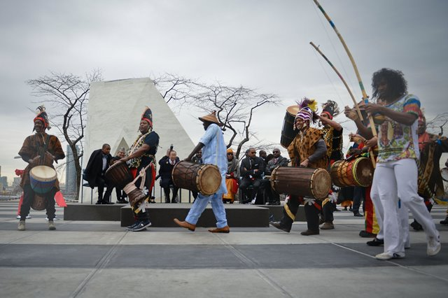 """Artists perform at the end of the unveiling ceremony of a permanent memorial named """"Ark of Return"""" to honour the victims of slavery and the transatlantic slave trade, at the UN headquarters in New York, on March 25, 2015. The UN unveiled a permanent memorial at the UN Headquarters in New York on Wednesday to honor the victims of slavery and the transatlantic slave trade. (Xinhua/Niu Xiaolei)"""