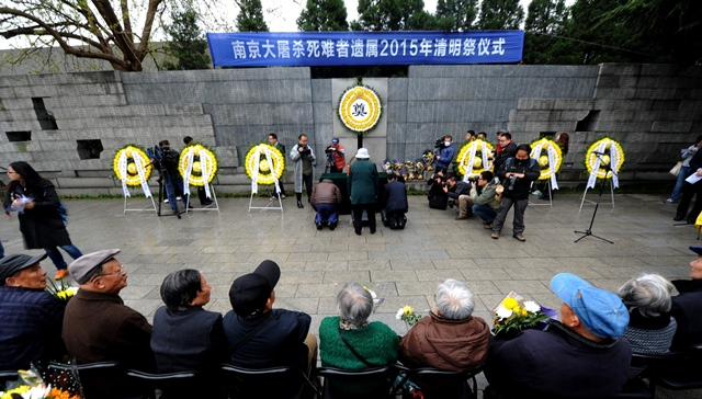 Survivors and relatives of victims of Nanjing Massacre take part in a ceremony to mourn the Nanjing Massacre victims in front of a wall inscribed the name list of victims at the Memorial Hall of the Victims in Nanjing Massacre by Japanese Invaders on Spring Festival in Nanjing, capital of east China's Jiangsu Province, April 5, 2015. Japanese troops captured Nanjing, then China's capital, on Dec. 13 of 1937 and started a 40-odd-day slaughter. More than 300,000 Chinese soldiers who had laid down their arms and civilians were murdered, and over 20,000 women were raped. (Xinhua/Han Yuqing) (lfj)