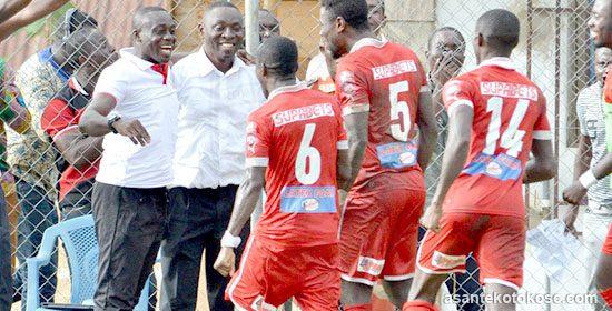 Asante Kotoko players celebrating with coach David Duncan and assistant Micheal Osei