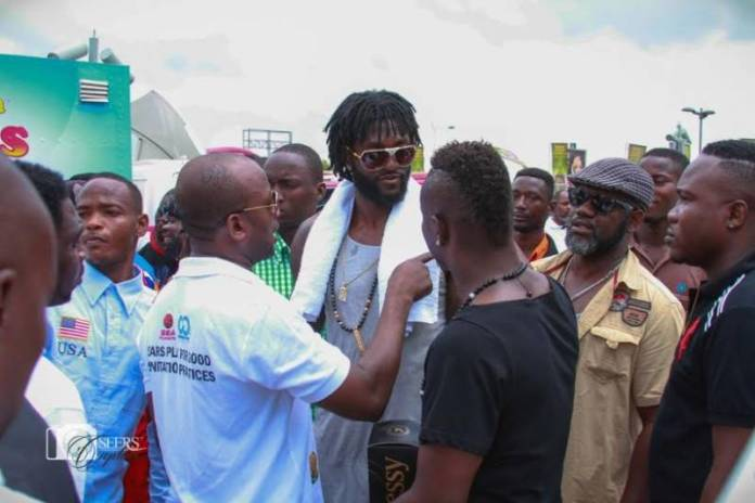 Adebayor recieving a brief from Samuel Anim