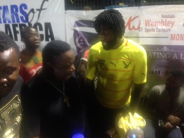 Mr. Ibu cracking up Emmanuel Adebayor on arrival