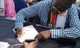 Col. Besigye Signs ICC Petition To Indict President Museveni