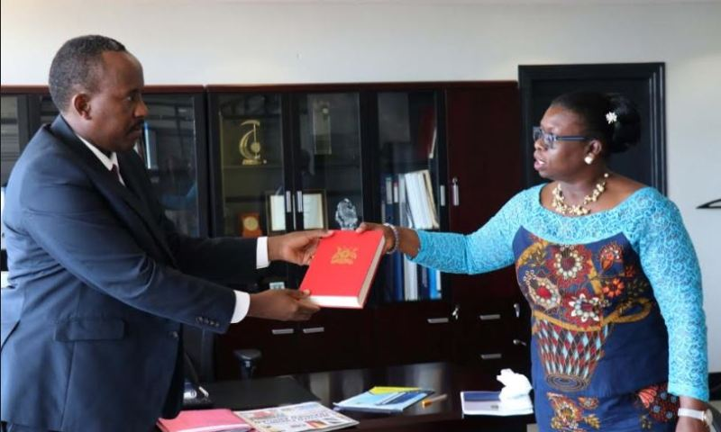Akol Hands Over Office To New URA Commissioner General Rujoki