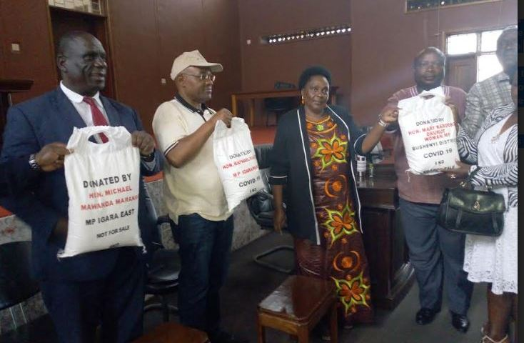 COVID-19: Ministers Karooro, Magezi & MP Mawanda Donate 60 Tonnes Of Posho To Bushenyi Task Force