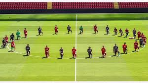 Liverpool Players Pay Tribute To Floyd By Taking Knee At Anfield, FIFA Speaks Out On Purnishing Them.