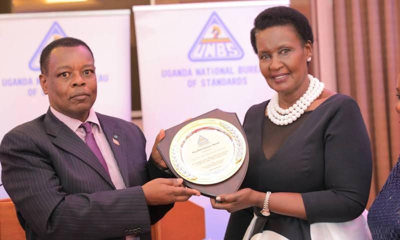 Trade Minister Amelia Kyambadde Applauds Former UNBS ED Dr. Ben Manyindo