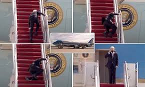 US President Joe Biden Falls Three Times Stumbling Up Stairs Of Air Force One
