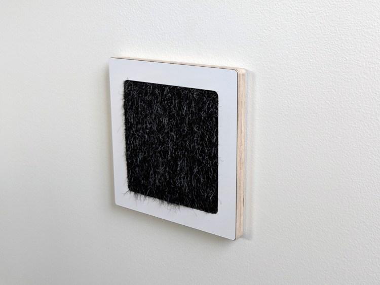 Modern wall cat scratcher in birch and black cat